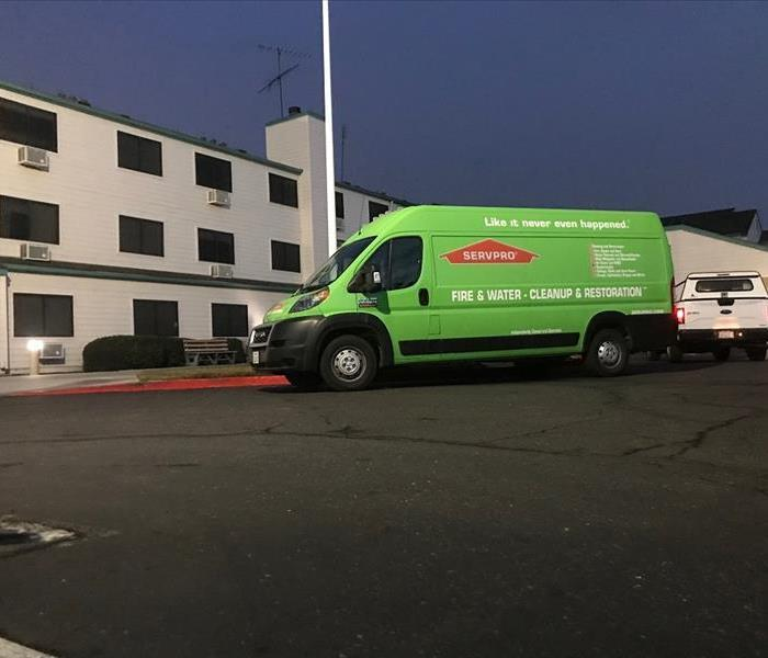 SERVPRO van parked outside of a building