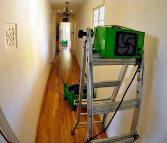 SERVPRO drying equipment placed in water damage hallway