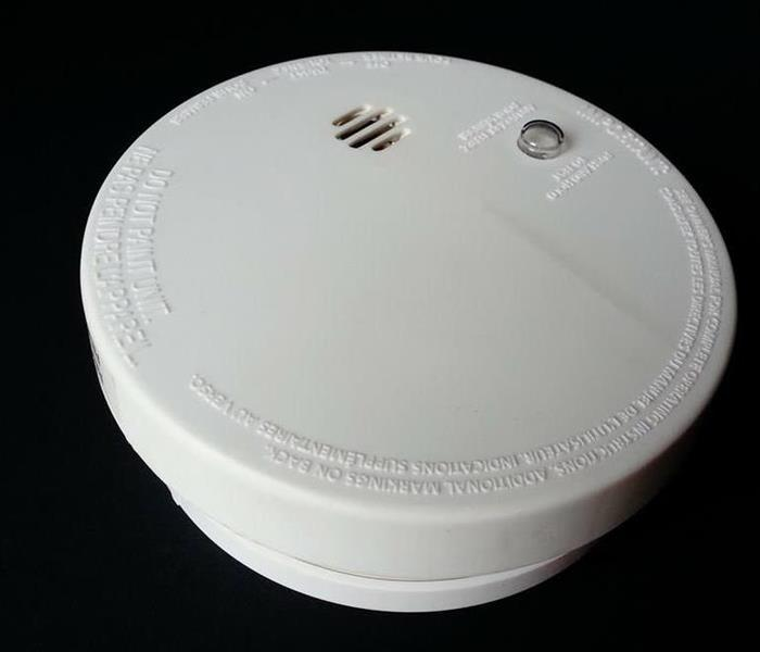 white smoke alarm with black background